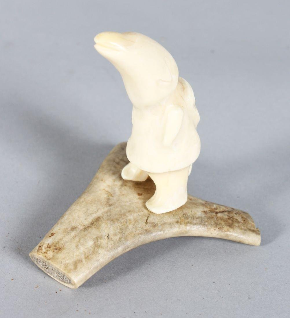 INUIT CARVING, POLAR BEAR TOOTH CARVED AS A POLAR BEAR,