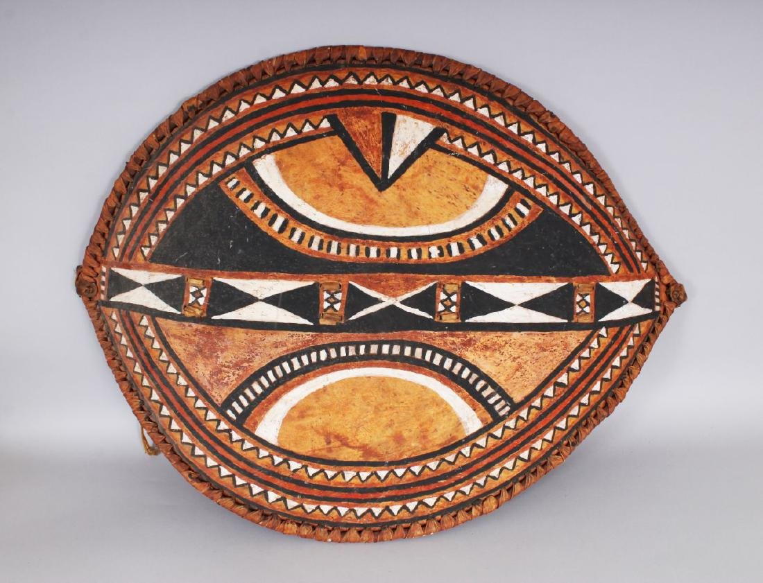 A LARGE AFRICAN ANIMAL SKIN SHIELD, with stylised