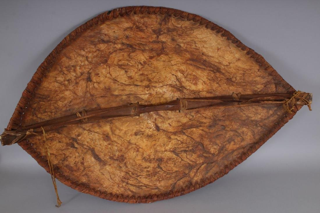 A LARGE AFRICAN ANIMAL SKIN SHIELD, with stylised - 2
