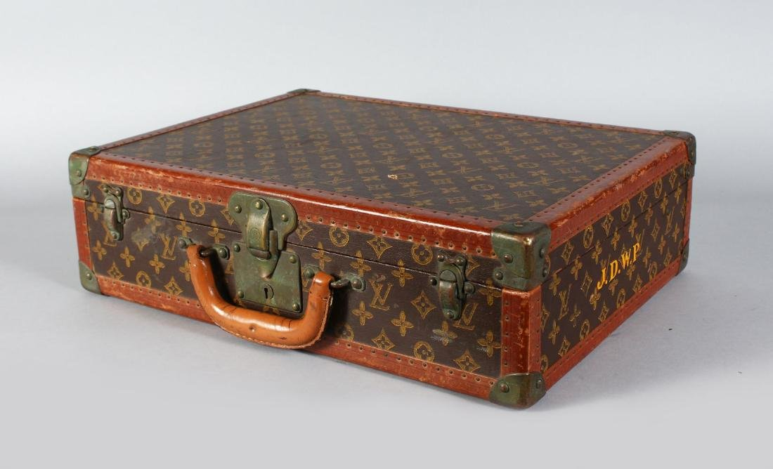 A LOUIS VUITTON BRASS BOUND LEATHER CASE.  Lock no.