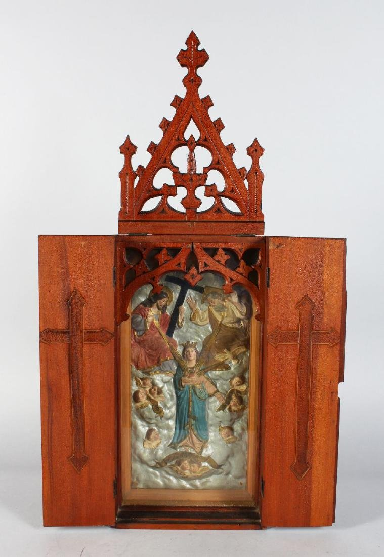A RUSSIAN TRAVELLING ICON in a folding wooden case.