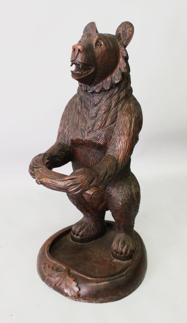 "A CARVED ""BLACK FOREST"" BEAR STICK STAND.  3ft 0ins"