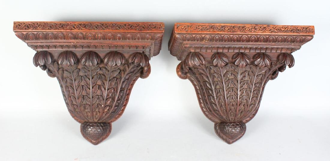 A GOOD PAIR OF CARVED MAHOGANY WALL BRACKETS.  17ins