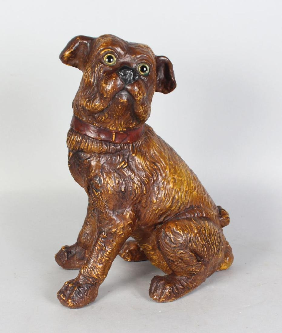 A 19TH CENTURY MOULDED POTTERY MODEL OF A SEATED DOG,