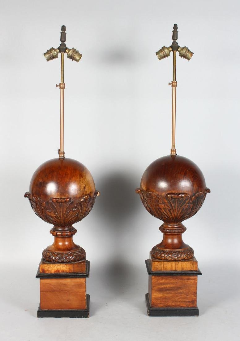 A PAIR OF 20TH CENTURY CARVED WOOD SPHERICAL TABLE