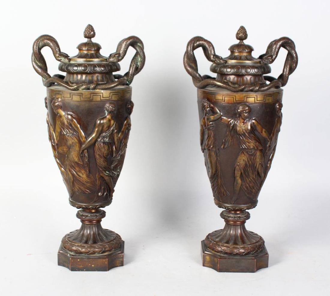 A GOOD PAIR OF 19TH CENTURY BRONZE URNS AND COVERS,
