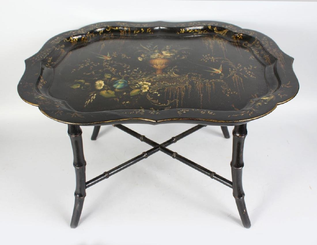 A REGENCY DESIGN PAPIER MACHE TRAY ON STAND, with