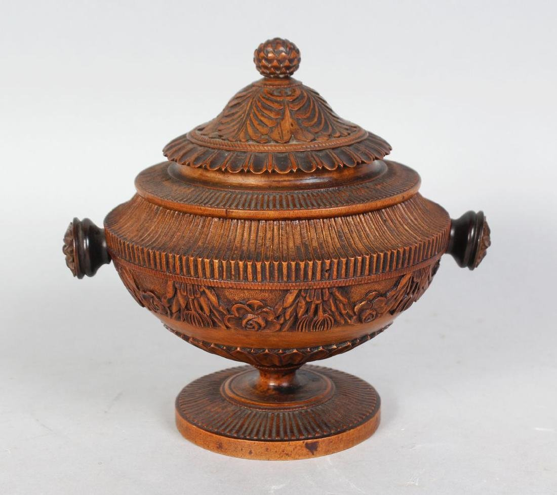 A GOOD SMALL TURNED WOOD BOWL AND COVER, with carved