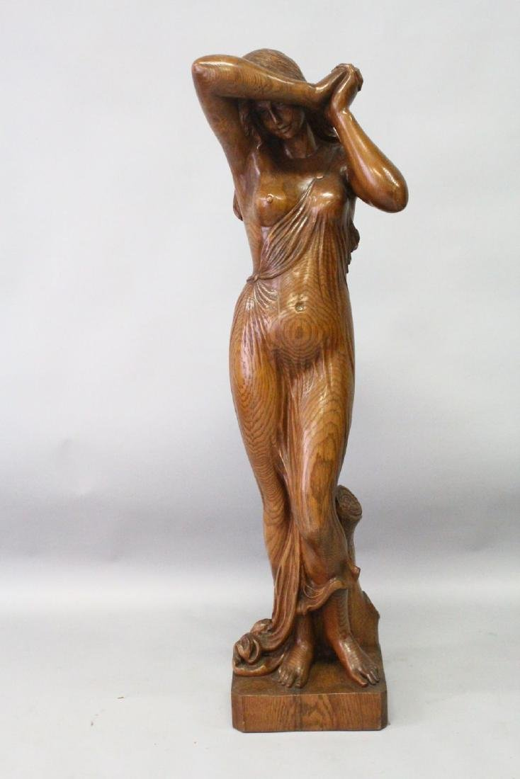 A GOOD 20TH CENTURY CARVED OAK FIGURE of a semi clad