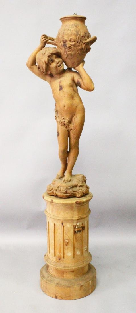 A CARVED PINE FIGURAL LAMP, modelled as a young boy