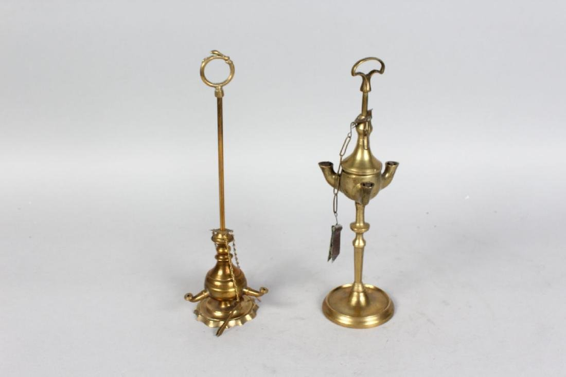 TWO BRASS OIL LAMPS.  10ins high.