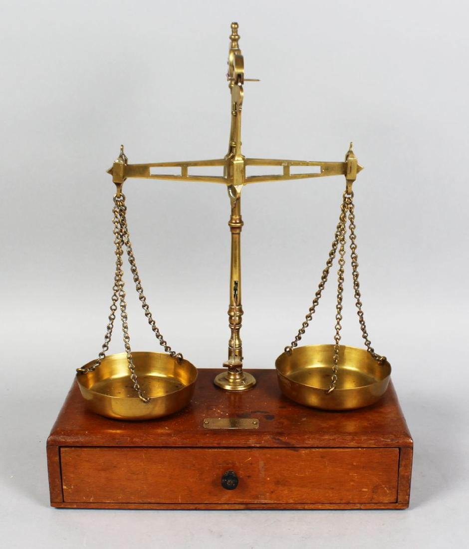 A 19TH CENTURY MAHOGANY AND BRASS SET OF BALANCE