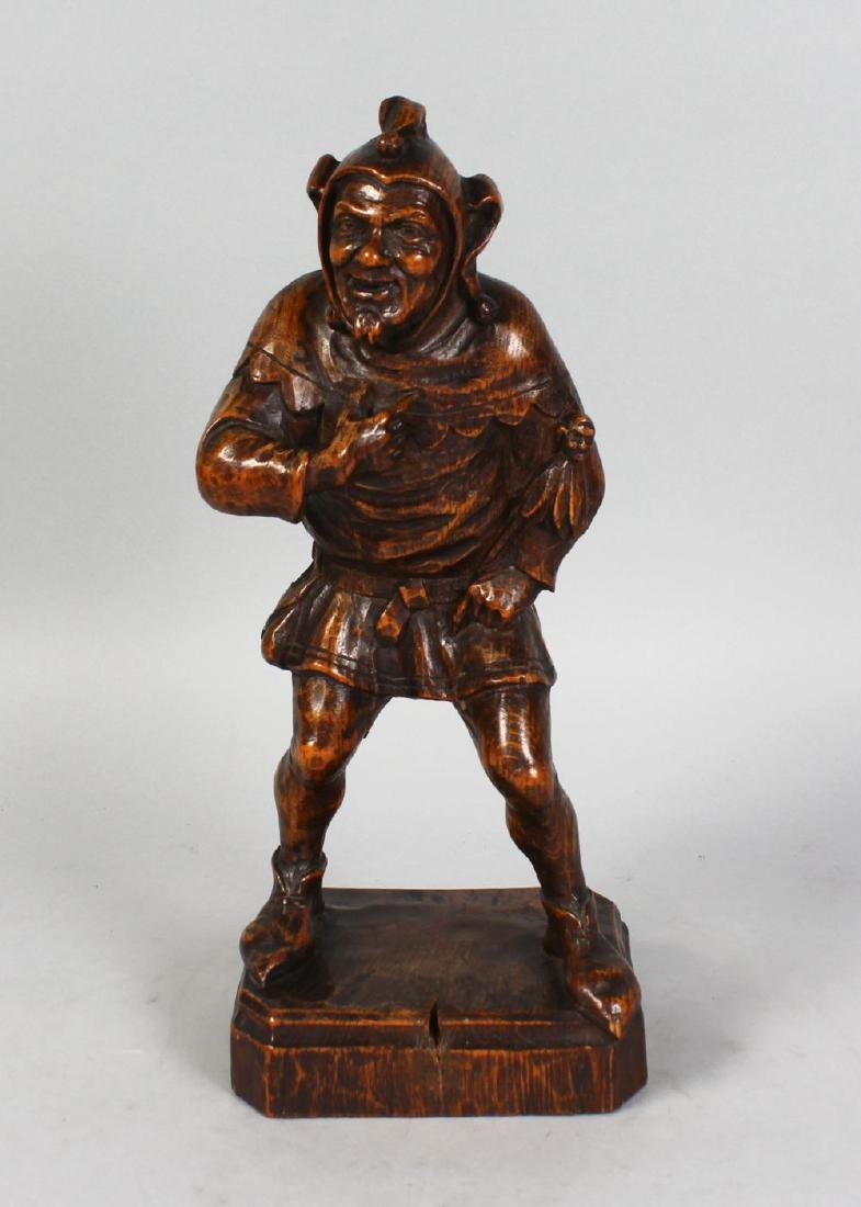 A GOOD BLACK FOREST CARVED WOOD FIGURE OF A JESTER,