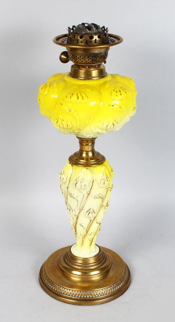 A GOOD VICTORIAN YELLOW MILK GLASS OIL LAMP on a brass