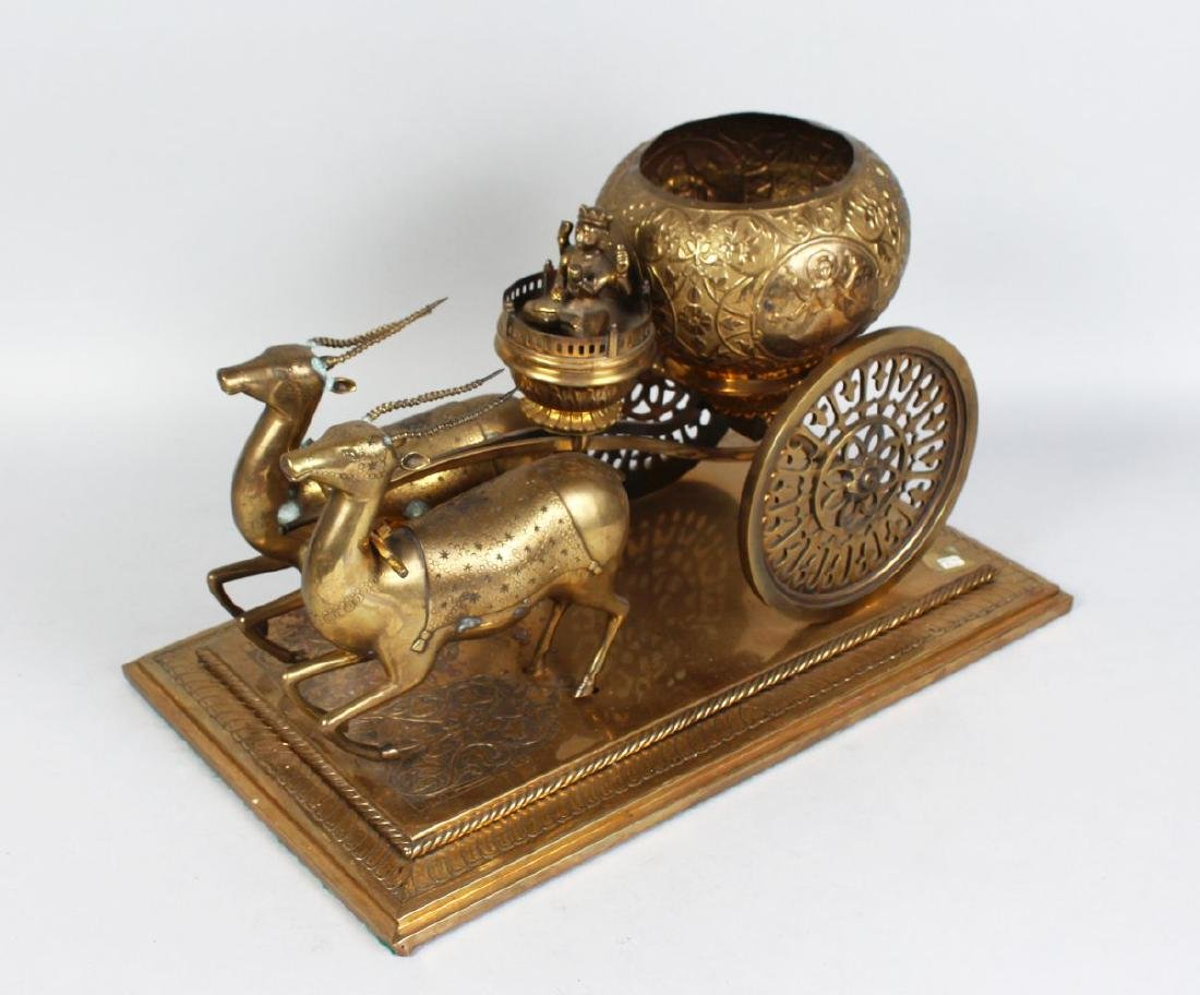 A LARGE INDIAN BRASS GROUP, TWO DEER PULLING A CART, on