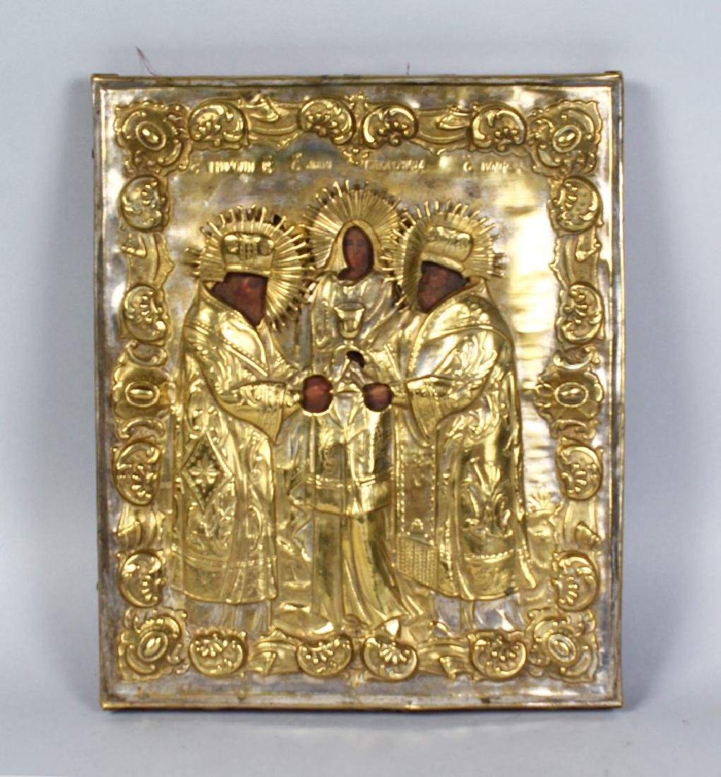 AN EARLY RUSSIAN BRASS AND PAINTED ICON.  13ins x