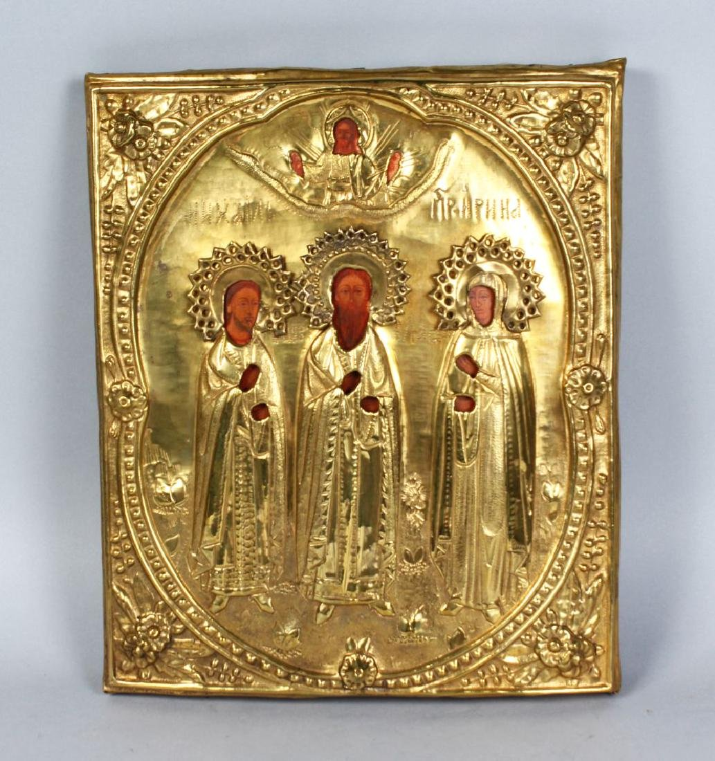 AN EARLY RUSSIAN BRASS AND PAINTED ICON.  12ins x