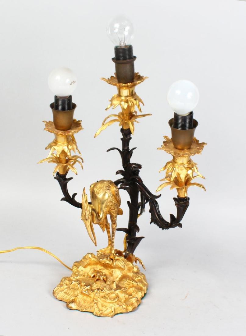 A GOOD FRENCH ORMOLU AND BRONZE THREE-LIGHT CANDELABRA,