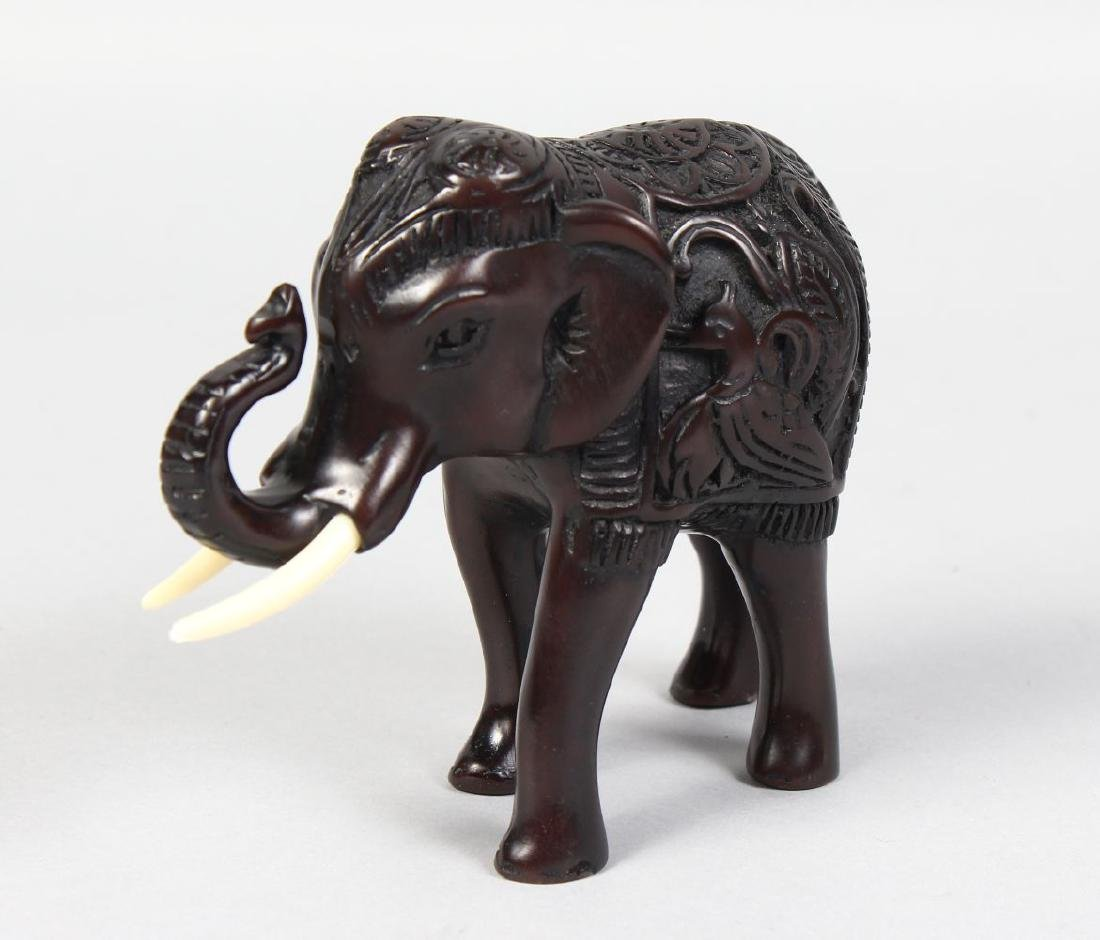 AN INDIAN CARVED EBONY ELEPHANT.  3.5ins high.