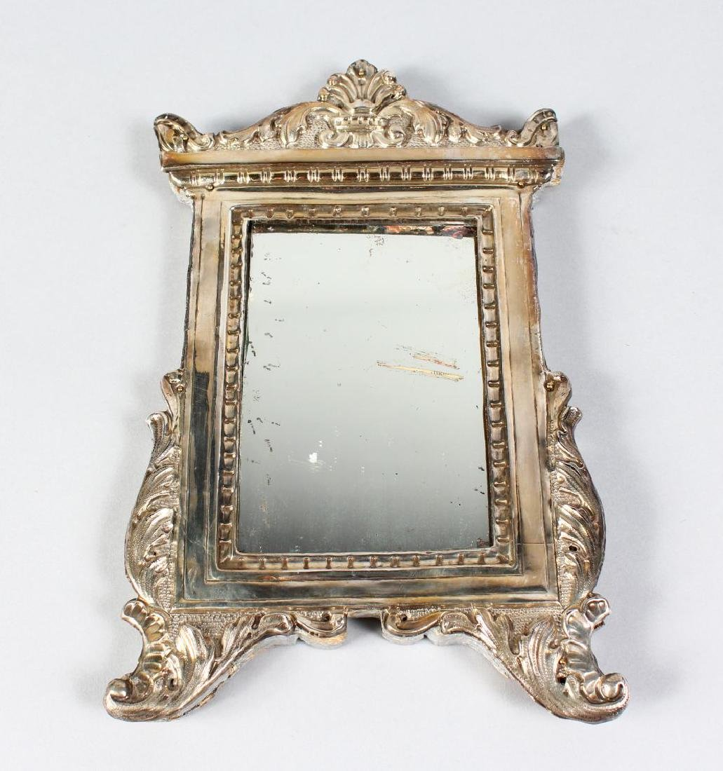 A SMALL ITALIAN UPRIGHT METAL FRAME MIRROR.  12ins high
