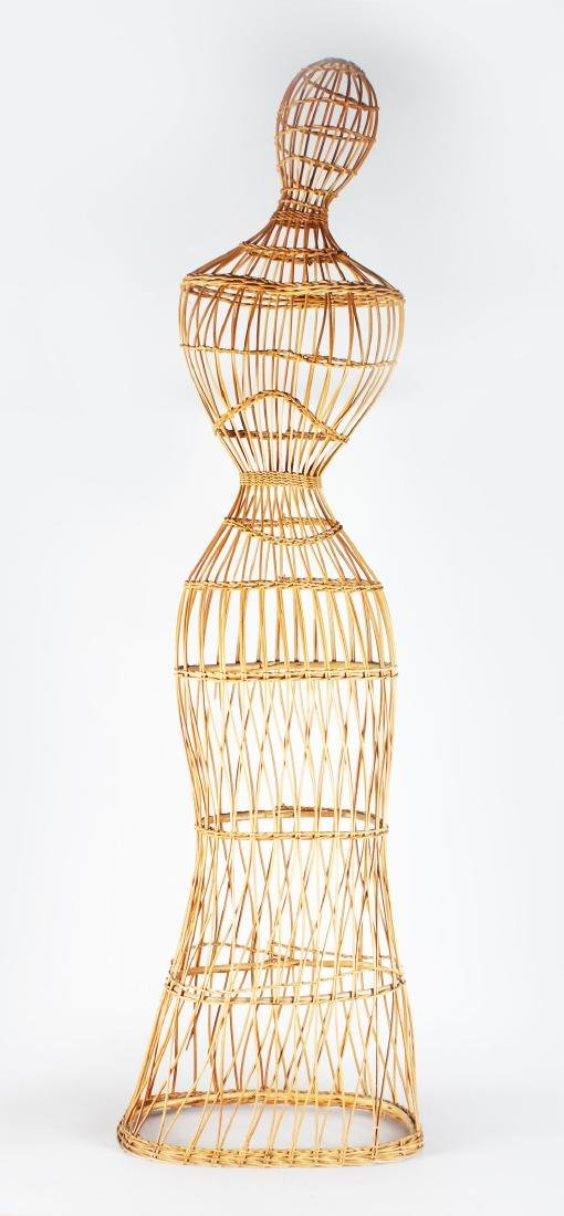 A 1920'S FRENCH OPEN CANEWORK MANNEQUIN.  5ft 7ins