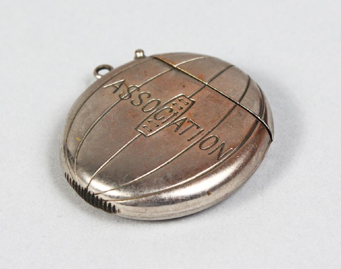 A METAL OVAL SHAPED VESTA, engraved ASSOCIATION.