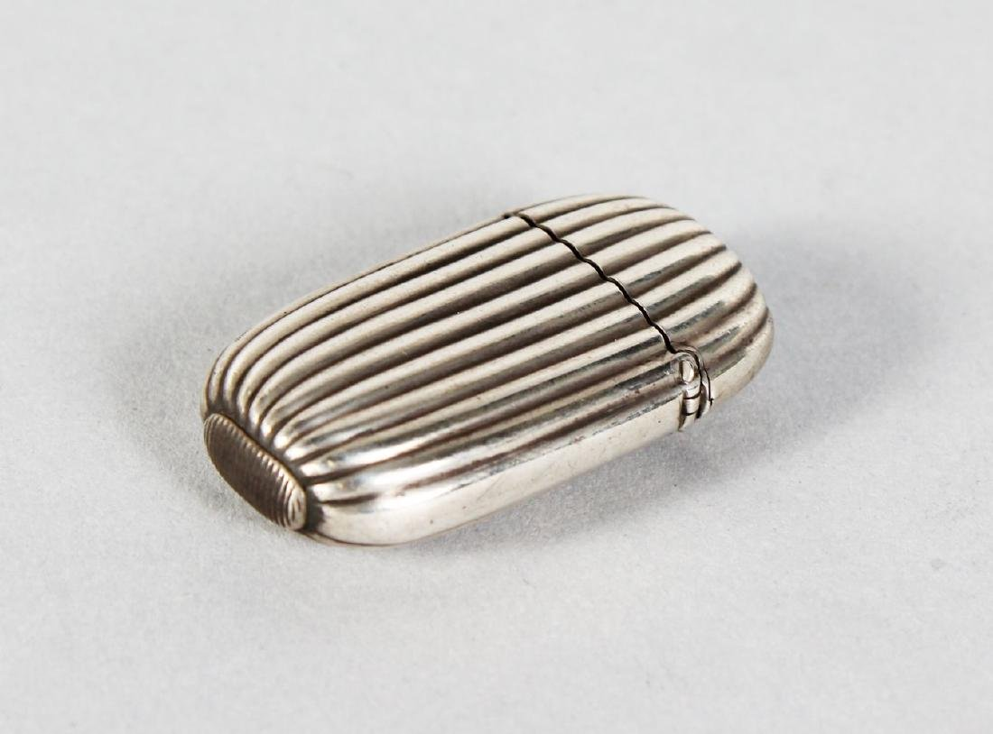 A VICTORIAN RIBBED SILVER VESTA.  London 1886.  Maker: