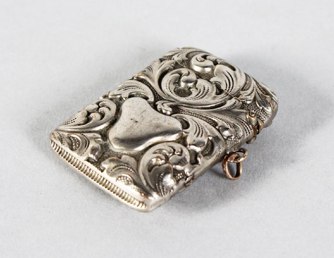 A PLATED VESTA with repousse decoration.