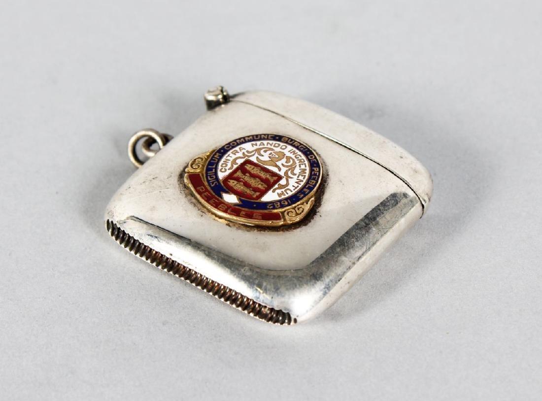 A PLAIN EPNS VESTA with an enamel crest of Peebles.