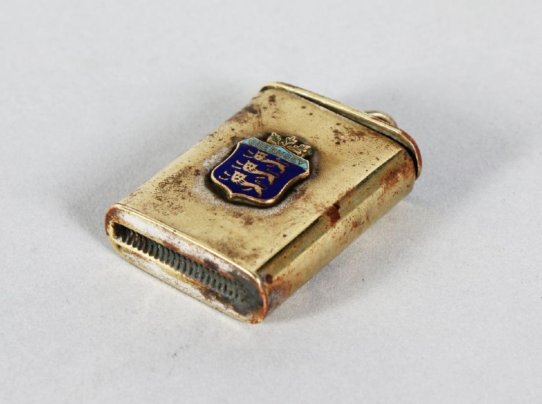 A PLATED VESTA with an enamel crest of GUERNSEY.