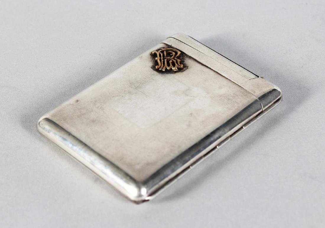 A VICTORIAN SILVER CIGARETTE CASE, with inset