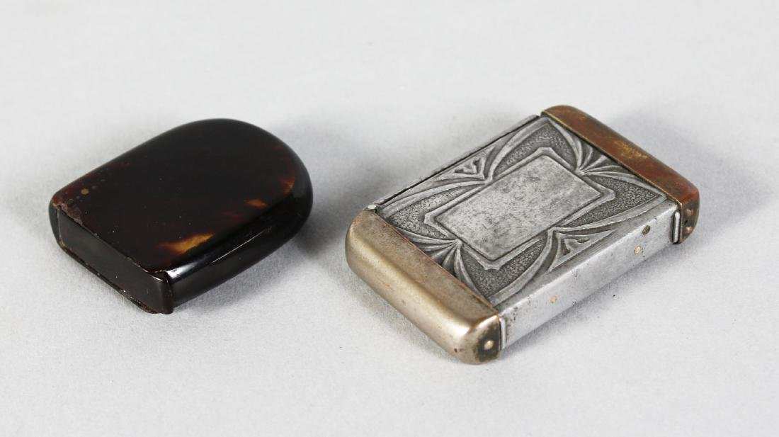 A METAL VESTA, with hinges left and right, and A