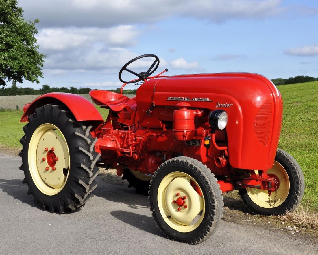 A 1961 PORSCHE JUNIOR RED SINGLE CYLINDER TRACTOR,
