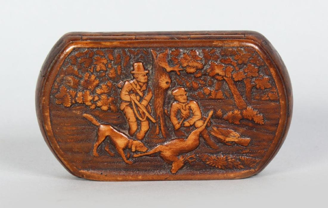 A BURR WOOD SNUFF BOX, carved with a hunting scene.