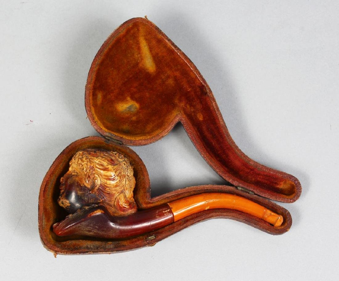 A MEERSCHAUM PIPE, head of a boy in a leather case.