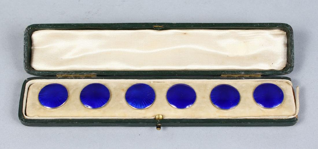 A SET OF SIX SILVER AND BLUE ENAMEL BUTTONS.