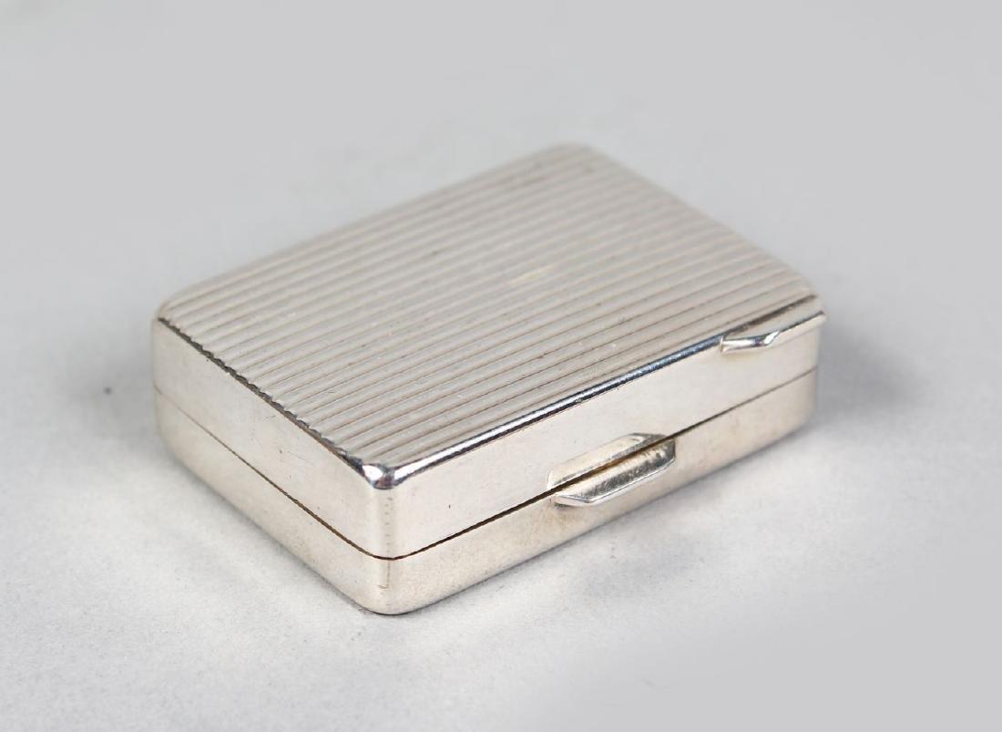 A RIBBED PILL BOX.
