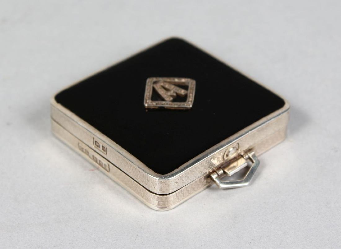 A SILVER AND ENAMEL SQUARE COMPACT, Initial A.