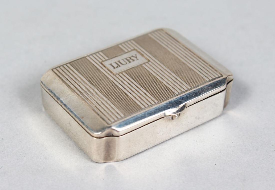 A .800 SILVER ENGINE TURNED SNUFF BOX.  Engraved LIUBY.