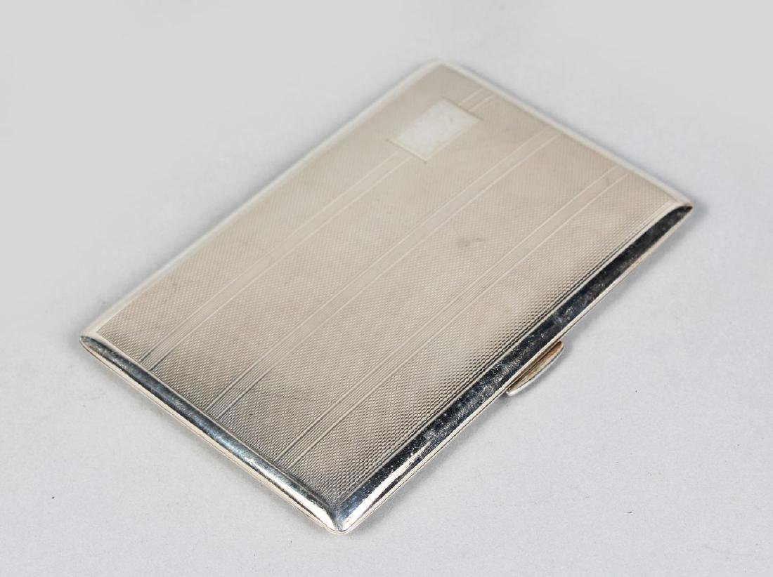 A GOOD ENGINE TURNED CIGARETTE CASE.