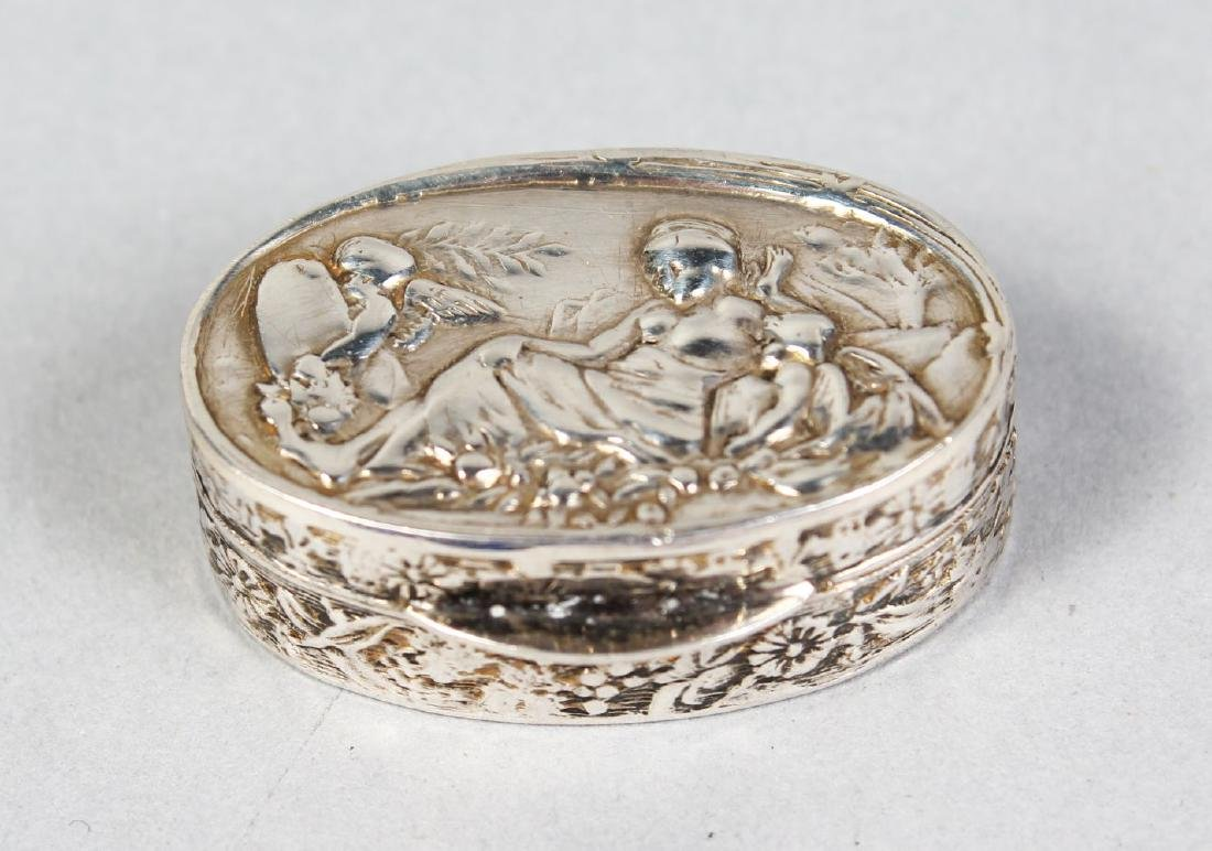 A SMALL OVAL SILVER PILL BOX, fruiting vines and