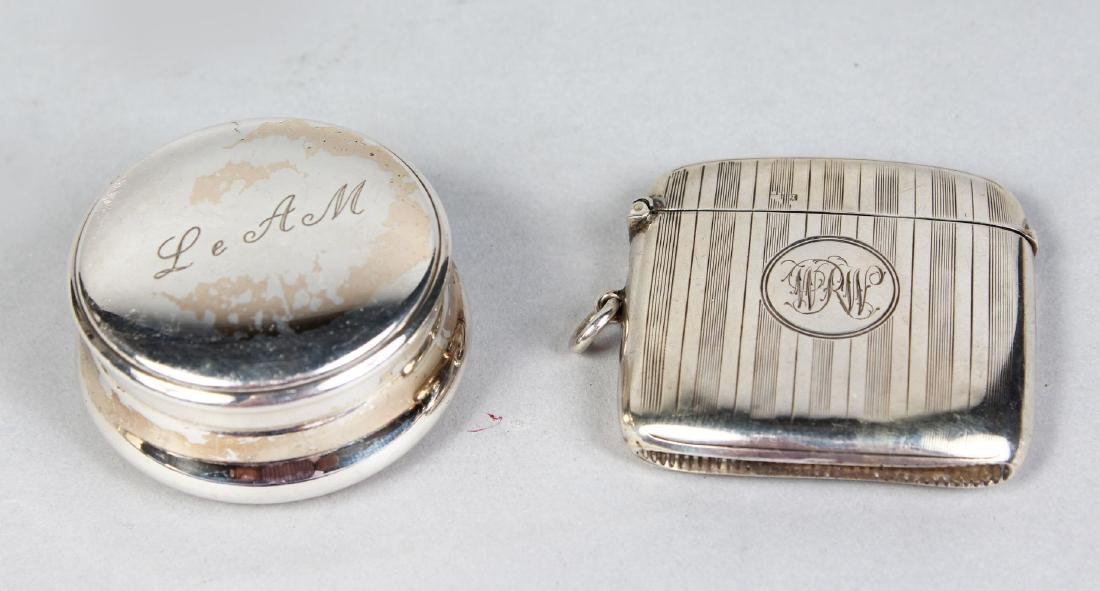 A CIRCULAR SILVER PILL BOX and AN ENGINE TURNED VESTA.