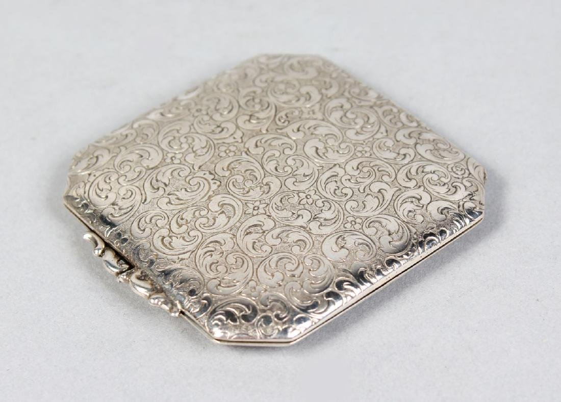 AN ENGRAVED COMPACT.