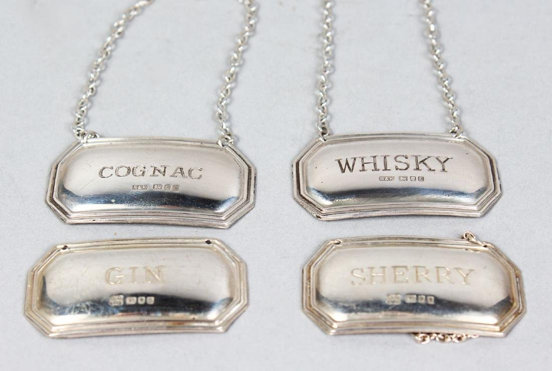 FOUR SILVER DECANTER LABELS, Cognac, Whisky, Sherry and