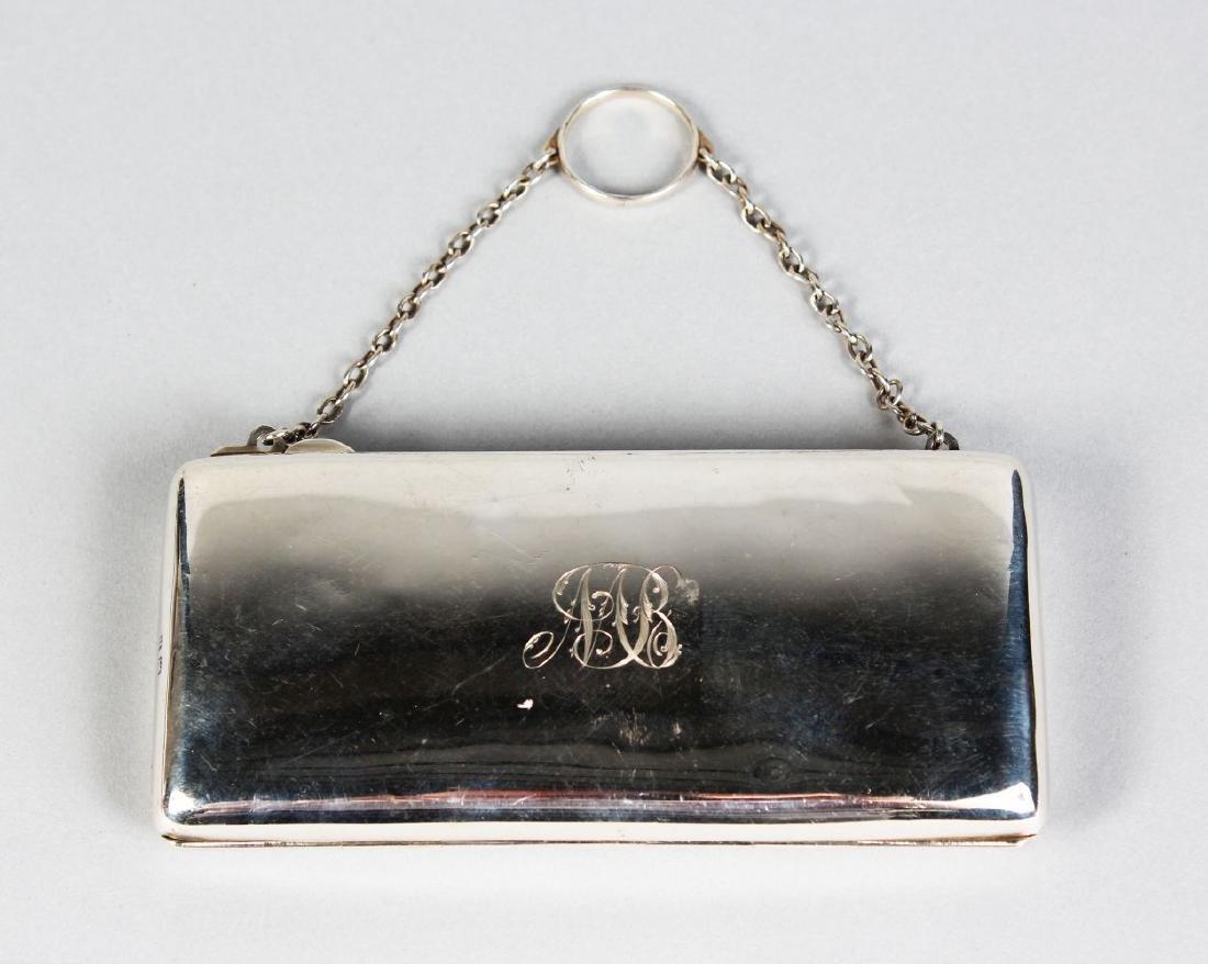 A PLAIN SILVER PURSE with silver chain.  Birmingham