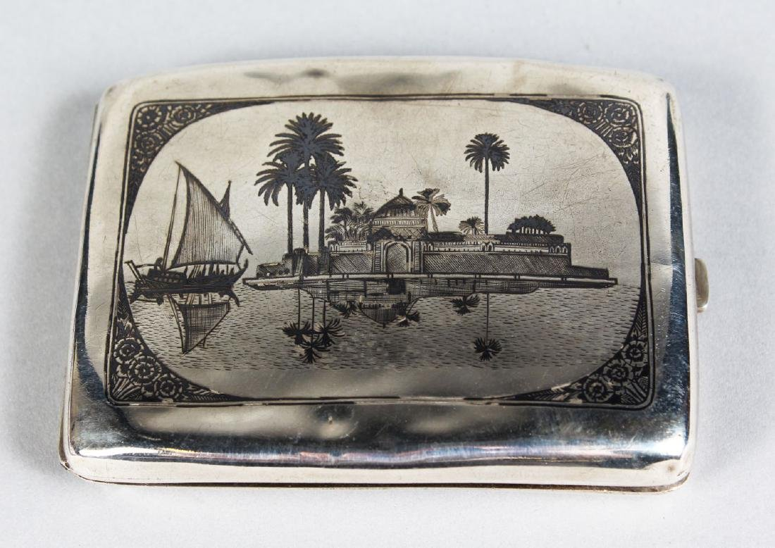 AN EGYPTIAN ENGRAVED WHITE METAL CIGARETTE CASE.  4ins