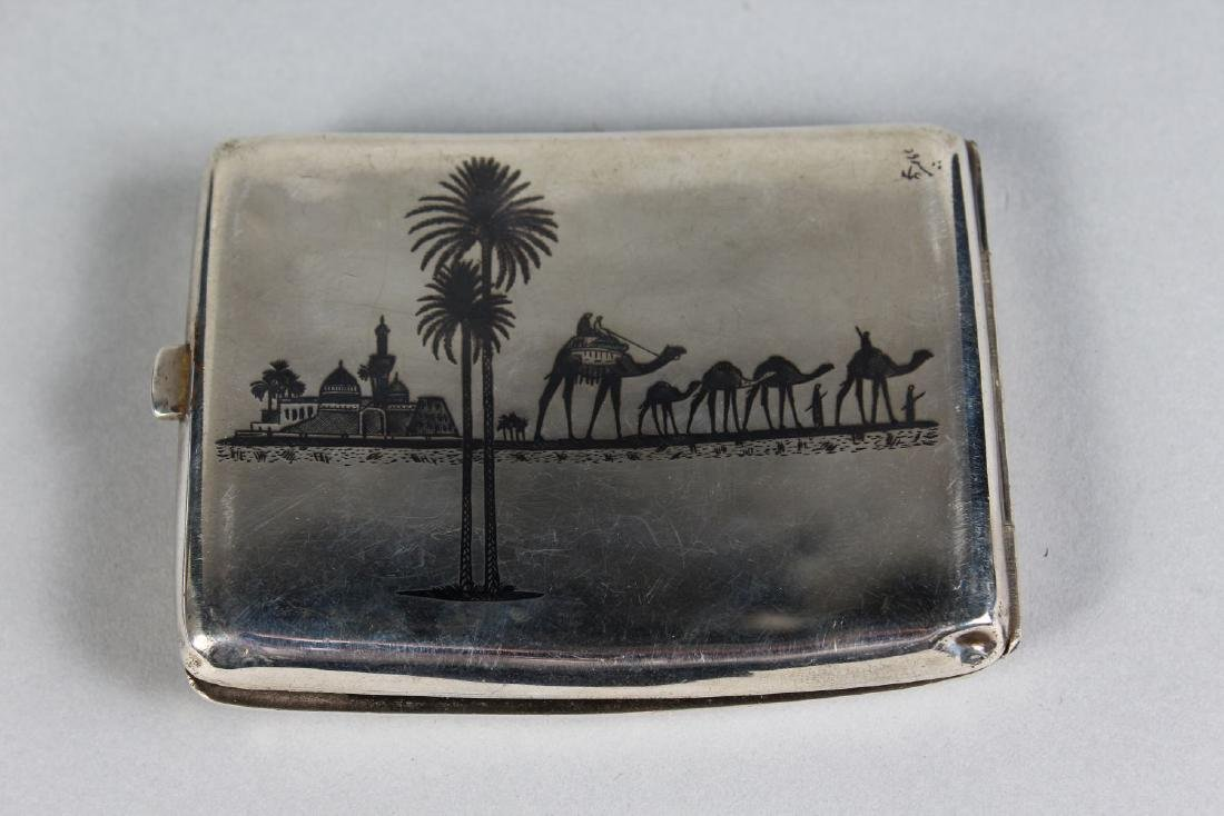 AN EGYPTIAN ENGRAVED WHITE METAL CIGARETTE CASE.  4ins - 2