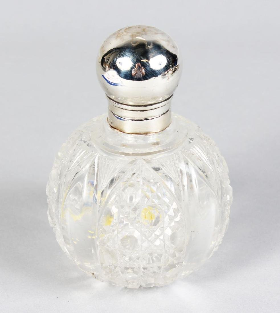 A VICTORIAN CUT GLASS GLOBULAR SCENT BOTTLE with silver