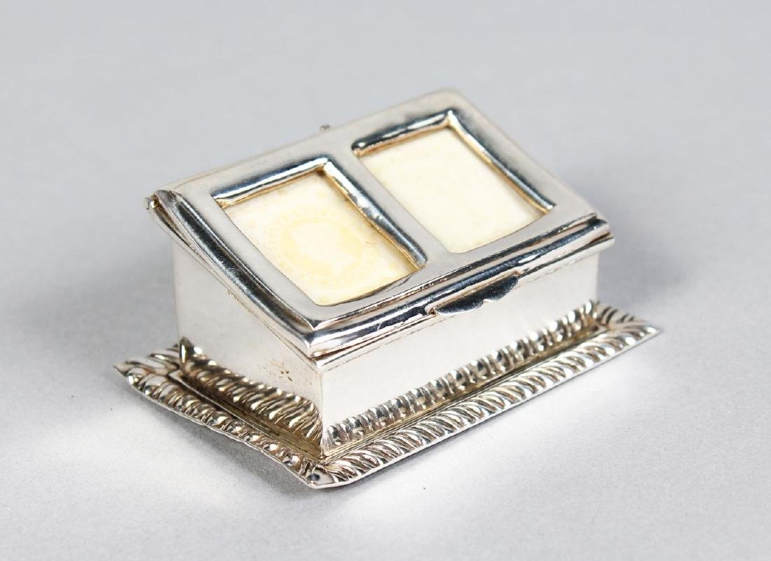 A TWO-DIVISION SILVER STAMP BOX, with lift up lid and