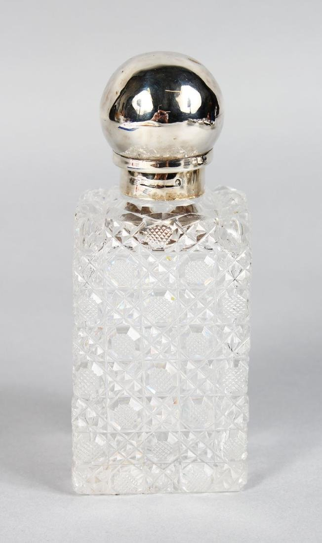A SQUARE VICTORIAN CUT GLASS SCENT BOTTLE, with plain